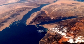 The Gulf of Suez from file. The Gulf is the left of the two channels, with the main Red Sea below. (Image: NASA.)