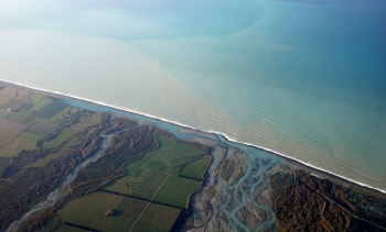 Ariel view of the mouth of the Rakaia River, from file. The wreck site is nearby. (Image: Phillip Capper.)