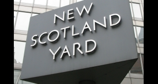 "The revolving sign outside Metropolitan Police HQ. (Image: ""Man vyi"".)"