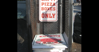 File photo of empty pizza boxes. (Image: Connie at Flickr.)
