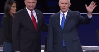 Tim Kaine and Mike Pence embrace before the vice presidential debate with moderator Elaine Quijano looking on. (Image: NBC News.)
