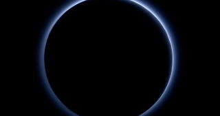 The blue haze of Pluto. (Image: NASA.)