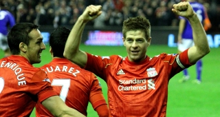 Gerrard celebrates with teammates after scoring a goal in 2012. (Image: Ruaraidh Gillies.)