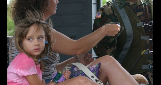 File photo of a Texas family being rescued from flood conditions, 2007. (Image: Unknown U.S. Army official.)